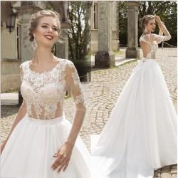 robe de mariée princesse buste en dentelle transparente